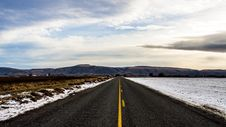 Free Straight Road With Melting Snow Stock Photography - 82985612