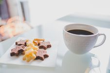 Free White Tea Cup Beside White Square Saucer With Star Shaped Cookies Royalty Free Stock Photos - 82985648