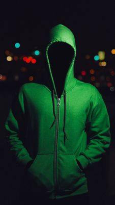 Free Faceless Person In Green Hoodie Stock Images - 82985784