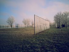 Free Trees On Field Near Fence During Daytime Stock Photography - 82985872