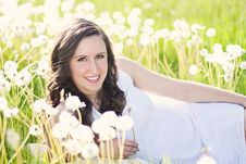 Free Woman In White Sleeveless Dress Lying On Green Grass Field Royalty Free Stock Photo - 82985875