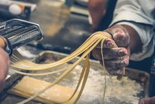 Free Hands Making Fresh Pasta Royalty Free Stock Photo - 82986185