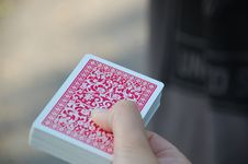 Free Deck Of Cards In Hand Royalty Free Stock Photography - 82986707