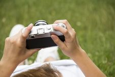 Free Person In White Dress Holding Grey And Black Camera On Grassland Stock Photography - 82986802
