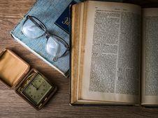 Free Eyeglasses Next To Open Book Stock Photos - 82986913