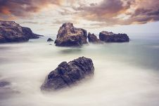 Free Rocks And Mists By The Ocean Royalty Free Stock Image - 82987236
