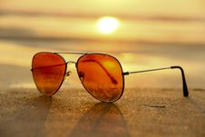 Free Sunglasses On Beach At Sunset Royalty Free Stock Images - 82987339