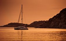 Free Boat Anchored In Sunset Royalty Free Stock Images - 82987709