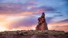 Free Sunset Over Desert Rock Stack Formation Stock Photo - 82987780