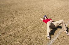 Free Men In Red Shirt Lying On A Brown Ground During Daytime Stock Photos - 82987893