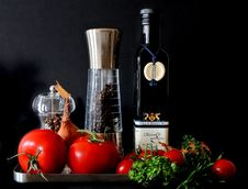 Free Tomatoes Beside Shakers And Olive Oil Bottle Royalty Free Stock Photos - 82988348