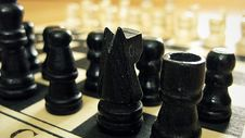 Free Black Chess Pieces On Chess Board Royalty Free Stock Photos - 82988368