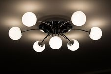 Free Silver Flush Mount Ceiling Light With Seven White Globe Lights Stock Image - 82988491