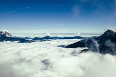 Free Black Mountain Over White Clouds Stock Images - 82989004