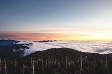 Free Sunset Over Mountain Clouds Royalty Free Stock Photos - 82989068