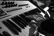 Free Person Playing Electric Piano In Grayscale Photo Stock Image - 82989071