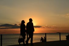 Free Man And Woman Silhouette Walking During Sunset Royalty Free Stock Images - 82989079