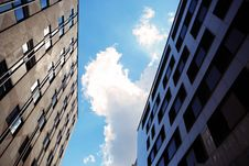 Free High Rise Buildings Against Blue Skies Stock Photos - 82989953