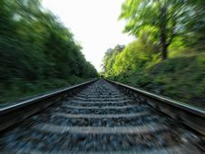Free Gray Metal Railway Across In Green Trees During Day Time Stock Images - 82990254