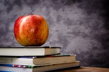 Free Red Apple On Black Book Royalty Free Stock Image - 82990376
