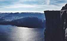 Free Cliff Over Mountain Lake Stock Photo - 82990460