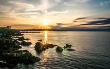 Free Sunset Over Rocky Ocean Coastline Stock Photo - 82990510