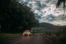 Free Yellow And White Police Car Lone On The Road Stock Photos - 82990513
