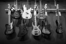 Free 8 Electric Guitars Hanged On Brown Steel Bar Royalty Free Stock Images - 82990579