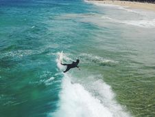 Free Surfer On Sandy Shores Stock Photos - 82990753