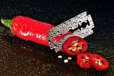 Free Red Chili Pepper Sliced By A Blade Stock Photography - 82990882