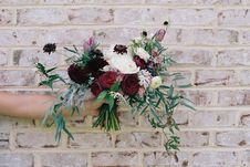 Free Bouquet Of Flowers Against Brick Wall Stock Photos - 82991113