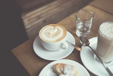 Free Cup Of Cappuccino Beside Glass Of Water And Glass Of Milk Stock Photography - 82991362