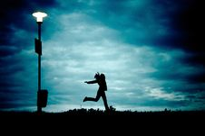 Free Silhouette Of Person Beside Silhouette Of Street Light Stock Photography - 82991542