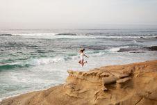 Free Women Wearing White Shirt Jumping On Shore Stock Images - 82991604