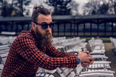 Free Man Wearing Black And Red Checkered Long Sleeve Shirt Wearing Black Wayfarer Sunglasses Sitting On White Wooden Chair Royalty Free Stock Photo - 82991695