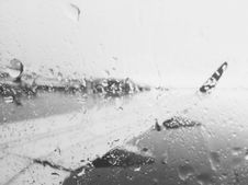 Free Airplane Wing Through Rainy Window Royalty Free Stock Photography - 82992657