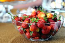 Free Red Strawberries In Clear Glass Bowl On Brown And Gray Textile Stock Photography - 82992892