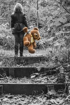 Free Girl In Jacket Carrying Brown Bear Plush Toy Selective Color Photo Stock Image - 82993341