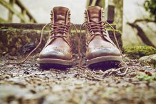 Free Brown Leather Work Boots On Ground Royalty Free Stock Image - 82993536