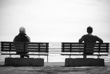 Free Grayscale Photo 2 Person Sitting In A Separate Benches On The Seaside Stock Image - 82994111