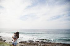 Free Mother Holding Her Baby In Front Of Seashore During Daytime Royalty Free Stock Photography - 82994167