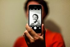 Free Man In Red Shirt Having Selfie On His Iphone In Grayscale Mode Royalty Free Stock Image - 82994626