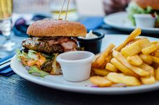 Free Fries And Burger On Plate Stock Images - 82994724