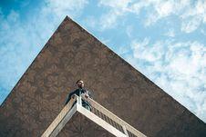 Free Man Stood On Building Balcony Stock Photo - 82995160
