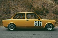 Free Yellow Sedan Beside Brown Leaf Plant During Daytime Royalty Free Stock Image - 82995216