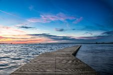Free Long Jetty Extending Over Lake Royalty Free Stock Images - 82995429