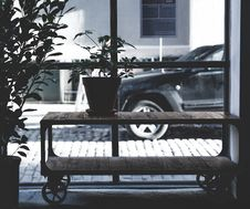 Free Green Potted Plant On Brown Wooden Table Across Black Car During Daytime Stock Photos - 82995513