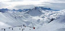 Free People Lurking Around On Snow Field Near Mountains Royalty Free Stock Photos - 82995548