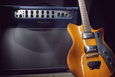 Free Brown Electric Guitar Beside Black Guitar Amplifier Stock Images - 82996524
