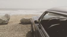Free Black Car Parked On The Seashore Stock Images - 82997774